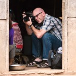 Jeffrey photographing in a Lao village • Laos+Angkor Within The Frame 2011 • photo: Victor Allen Rowley