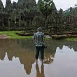 Jeffrey in a pool of water photographing Angkor Wat • Laos+Angkor Within The Frame 2011 • photo: Victor Allen Rowley