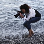 Photographing the pebbly beach • Liguria Within The Frame 2011 • photo: Marjan Leeuwesteijn