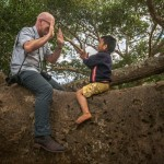 Jeffrey in a tree teaching patty cake to a Burmese boy • Burma Within The Frame 2013 • photo: Sarah Isaacs